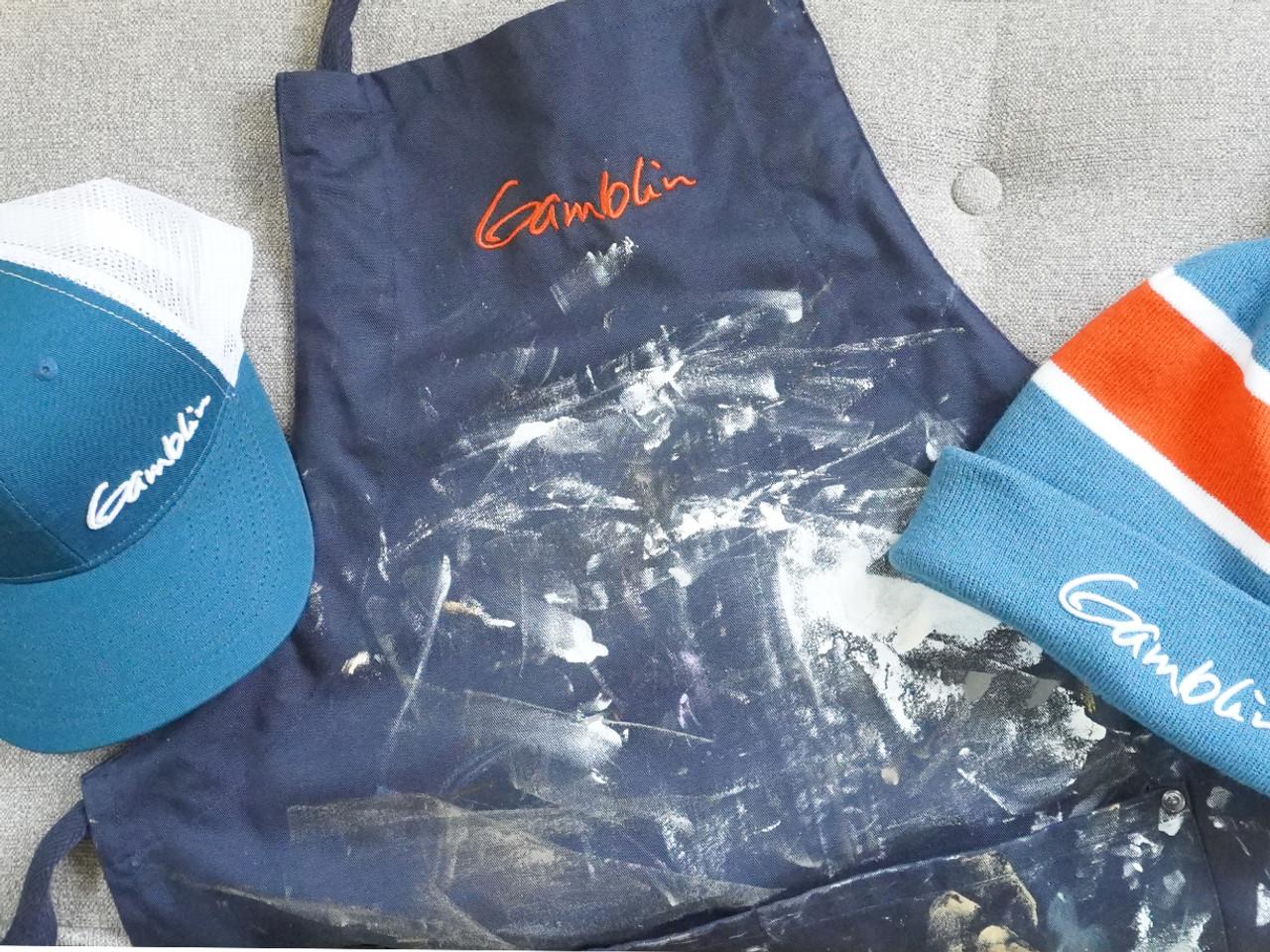 Gamblin blue meshback cap, apron, and pompom beanie