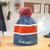 Gamblin pom-pom beanie, stocking cap, blue and red