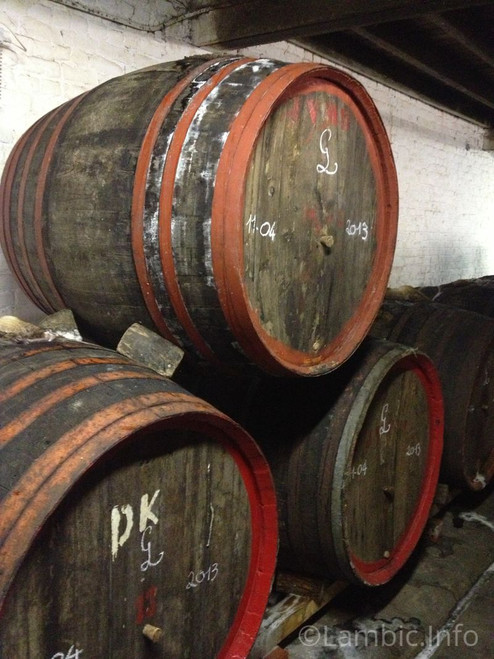 Barrels containing black cherry lambic of different ages, composing the final Hanssens oude Kriek.