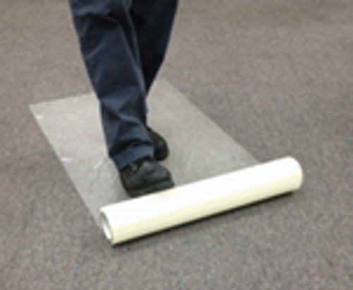 "Zip-Up Carpet protection film from www.leadPaintEPAsupplies.com, The Renovators Supply Store.  24"" x 200' Peel and stick adhesive technology being placed without optional applicator."