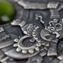 TONATIUH Sun Gods 2 oz Silver Coin with Olivine crystal Niue 2020