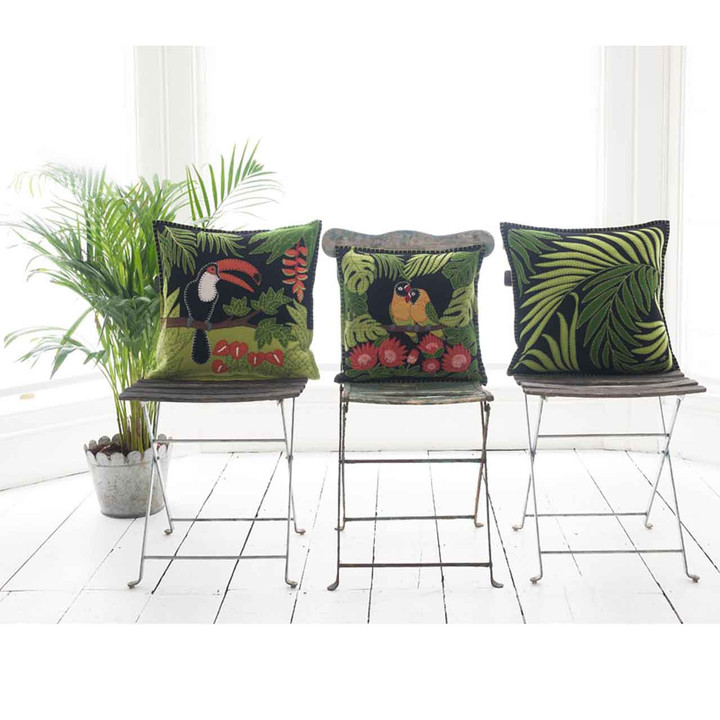 Tropical appliqué palm leaves hand-embroidered onto luxurious black wool felt cushion.