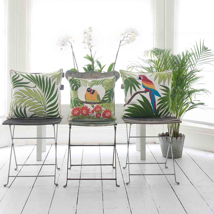 Luxury cream wool cushion with tropical leaf hand appliqué.