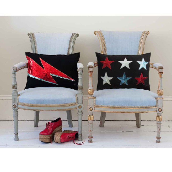 Black felt wool cushion with six Glam Rock inspired red white and blue sequin stars.