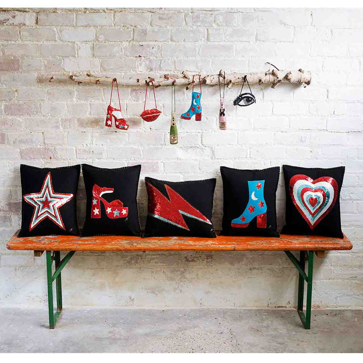 Black wool felt cushion with Glam Rock hand embroidered heart in red, oyster and blue sequins.