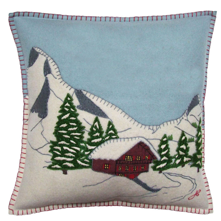 Luxury wool felt cushion featuring nostalgic ski chalet alpine scene in appliqué and hand stitched embroidery.