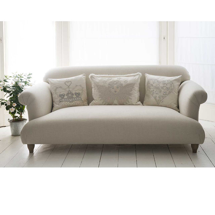 Luxurious hand-embroidered cream velvet cushion with silver hand stitched heart and diamanté crystal embellishment.