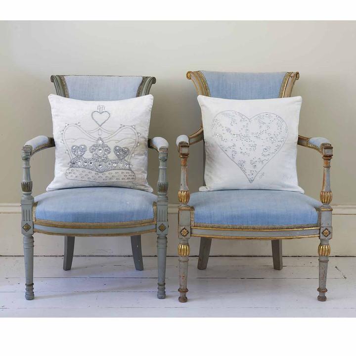 Silver hand embroidery and diamanté crystal heart on luxury cream velvet cushion.