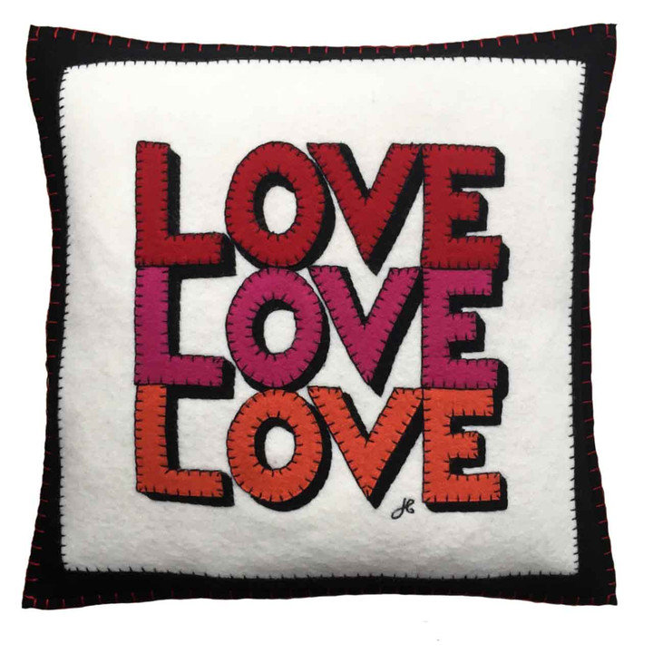 Designer square cushion in wool felt. Hand-stitched love slogan. Cream, black, red, pink. Valentine, pop art.
