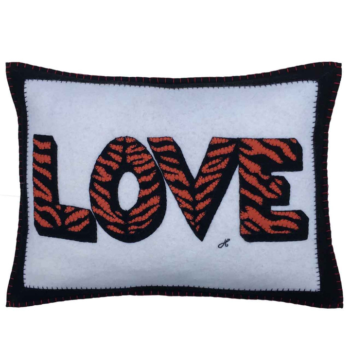 Designer rectangle love cushion. Cream, black wool felt with orange and black tiger skin hand-embroidery. Animal, Valentine.