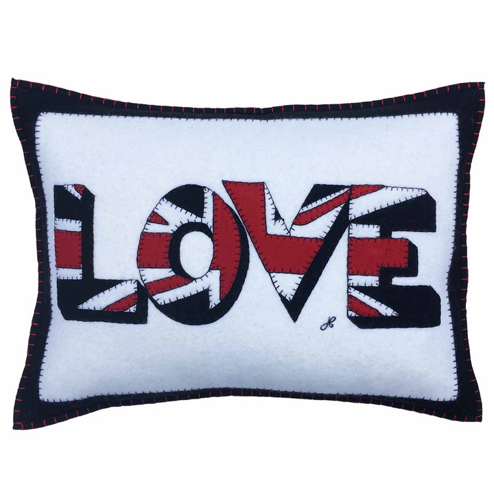 Designer oblong rectangle Love wool felt cushion. Union Jack appliqué letters, hand-embroidered. White, black, red wool felt. Pop art, Valentine.