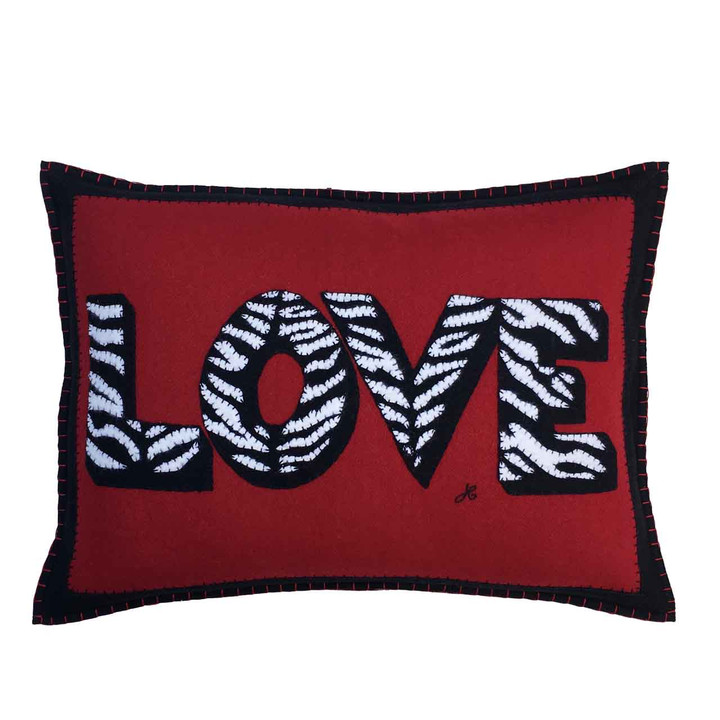 Big oblong ZEBRA pattern Love cushion. Hand embroidered black and cream lettering on luxury  red wool felt.