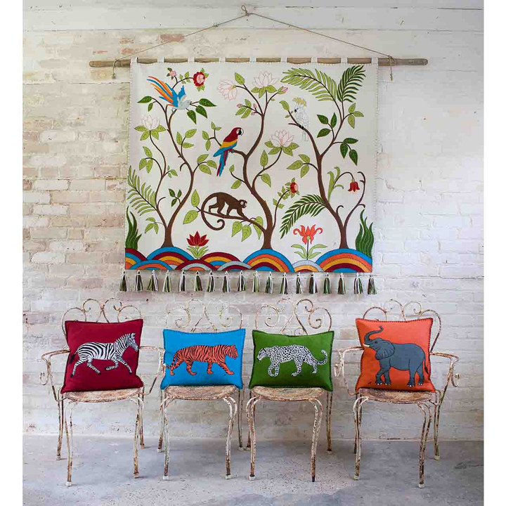 Tropical hand embroidered wall hanging. Jungle animals and birds in the rainforest. Cream, green, orange, blue, red and yellow.