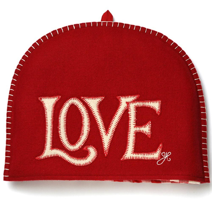 Cream love on red wool tea cosy