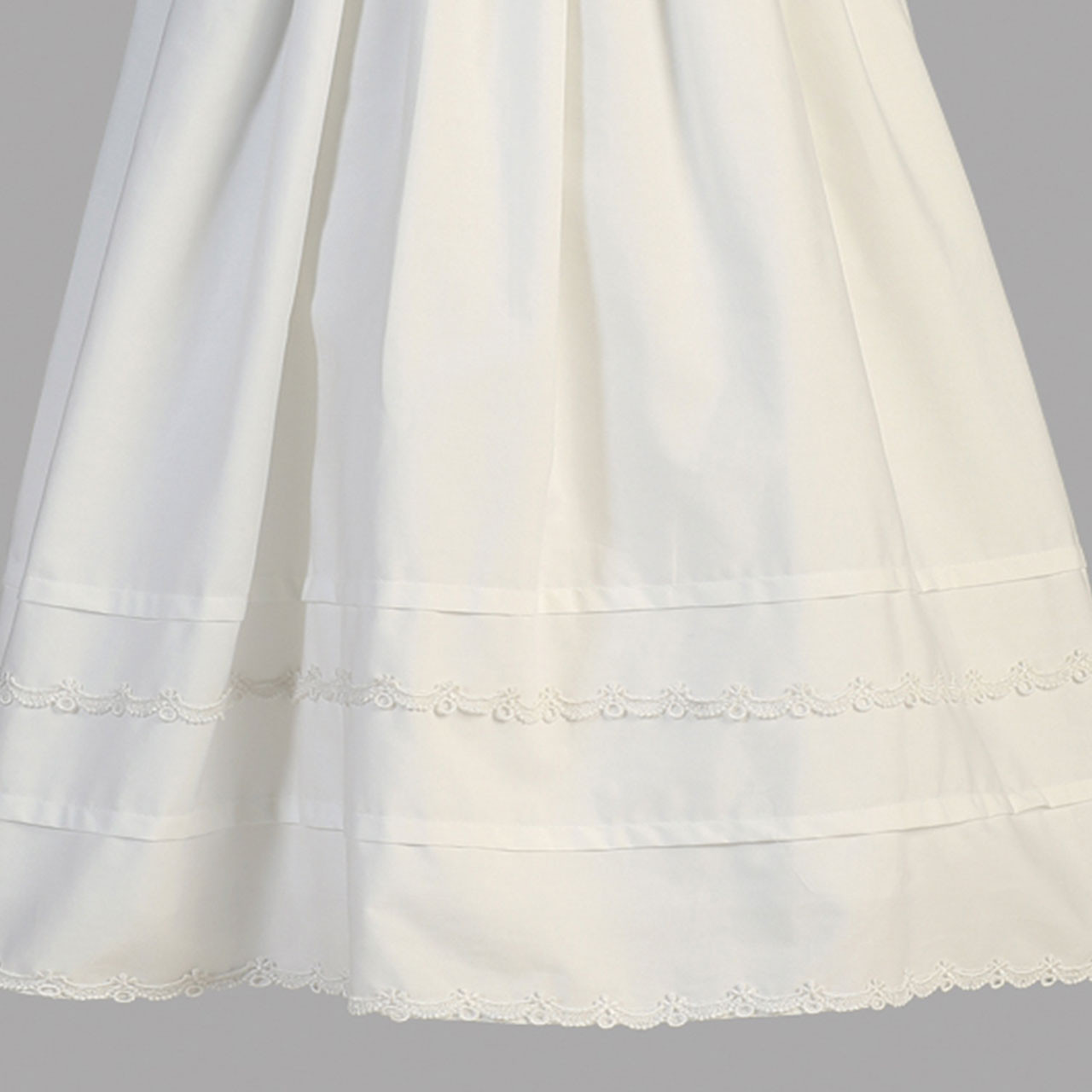 Detail of Embellished lower hem of Marie Cotton Christening Gown