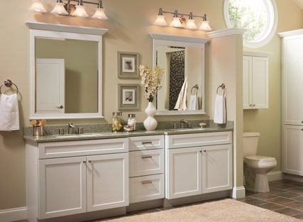 Traditional bathroom with two KraftMaid vanity sink bases in Thermofoil White
