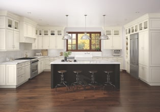 Transitional kitchen in Warm White finish with center seating island in Riverbed finish