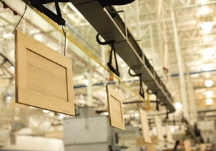 Overhead conveyor system moving cabinet doors through the manufacturing process at the KraftMaid Middlefield, Ohio, plant