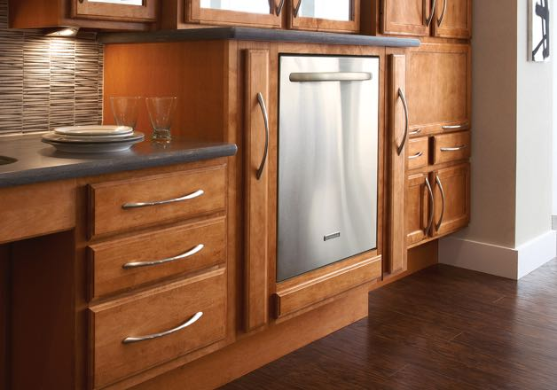 Kitchen with dishwasher installed in a raised cabinet for easier accessibility