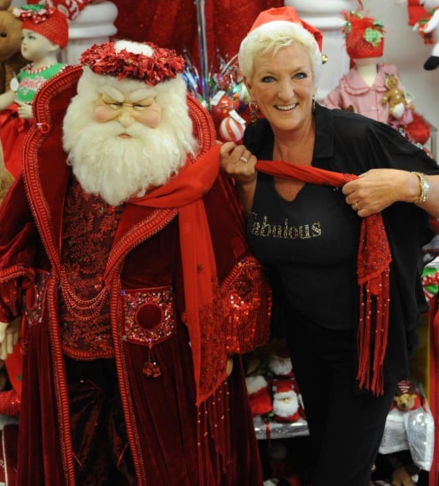 Diane Silverstein of Absolutely Fabulous with a Life-Sized Santa they sell.