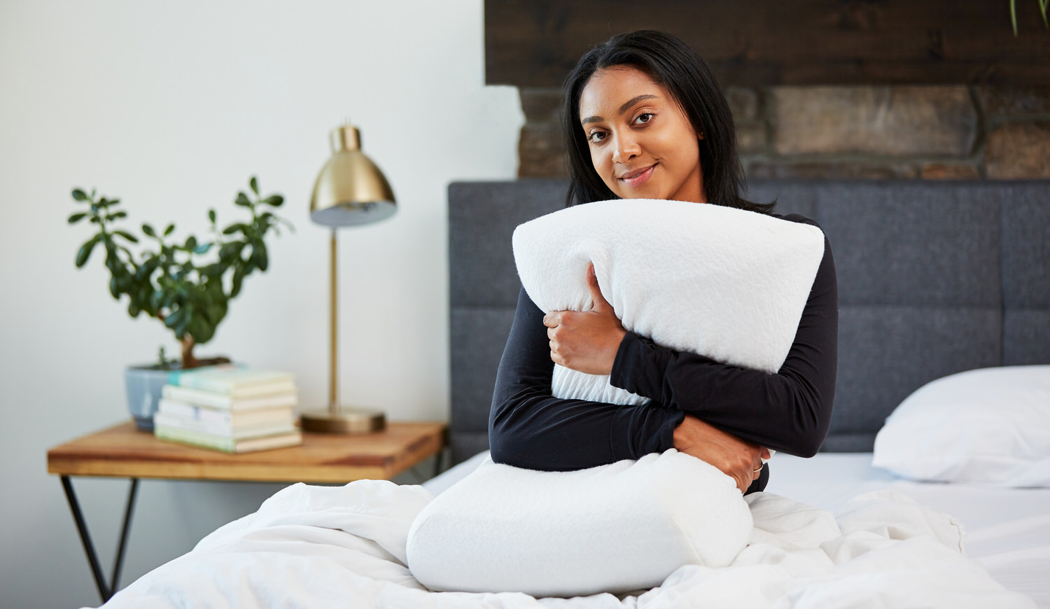 Woman hugging Moonbow Adjustable Plush Memory Pillow