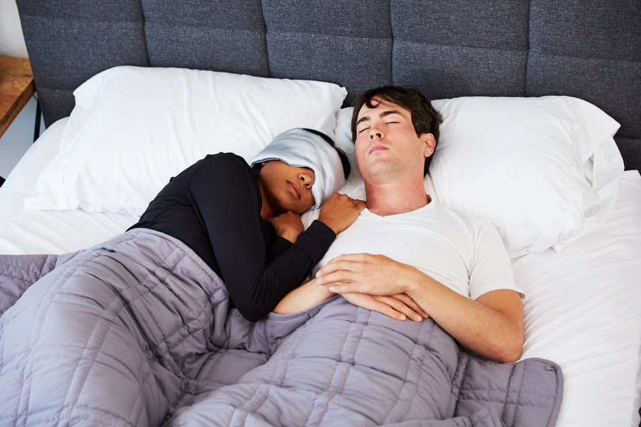 Couple sleeping with Moonbow Total Dark Satin Eye Mask