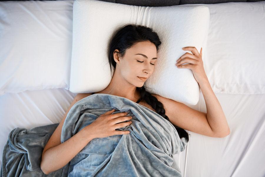 Woman sleeping on Moonbow Adjustable Plush Memory Pillow