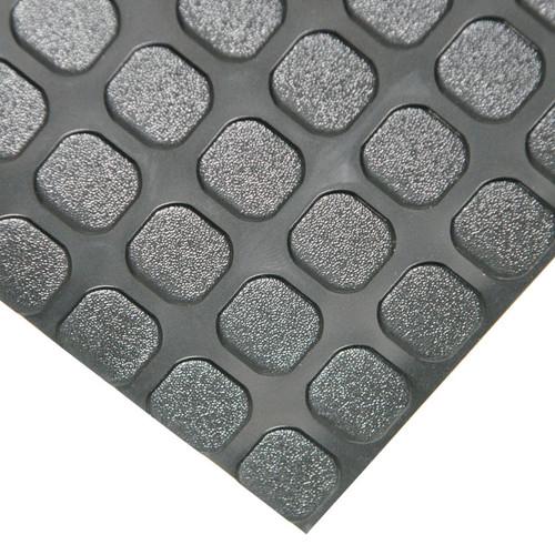 Corner of black block grip textured flooring