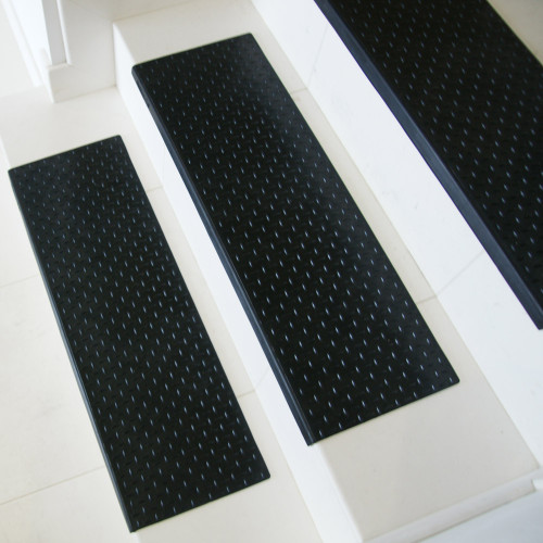 Side view of white stairs featuring Diamond-Plate Rubber Stair Mats