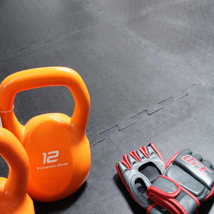 Armor Lock Tile Floor under 12lb Orange Kettlebells and Training gloves