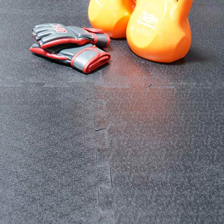 Armor Lock Tile Floor with Orange Kettlebells and Weightlifting gloves on top