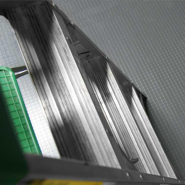 ladder on gray block grip pvc flooring roll in room