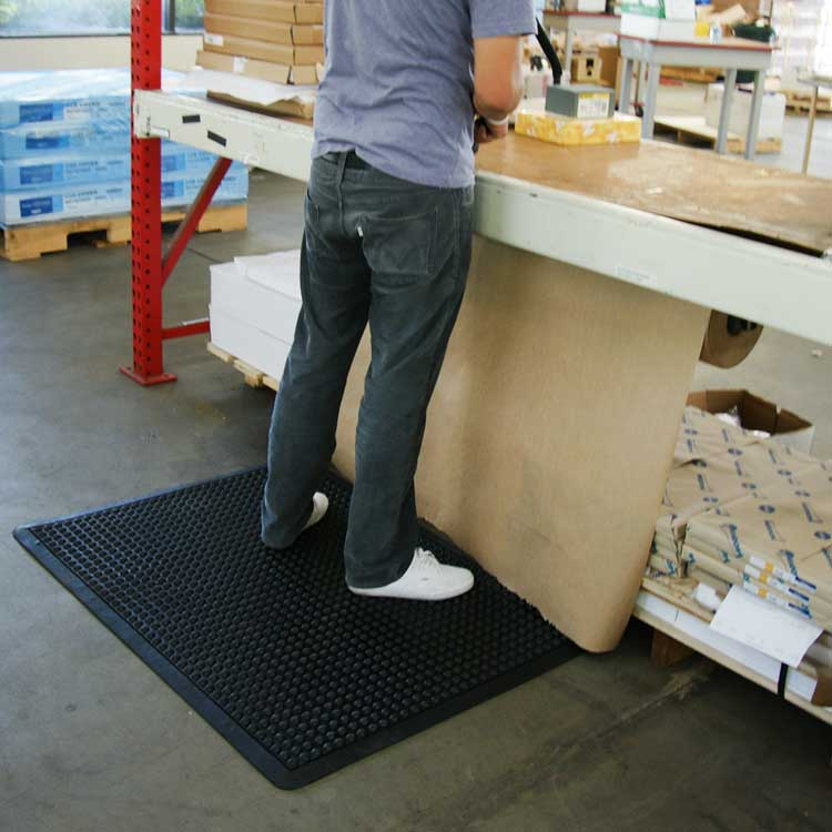 person standing brown Anti-Fatigue Mat in a warehouse