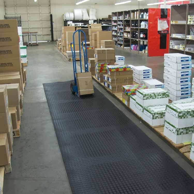 Black coin grip PVC flooring in a warehouse