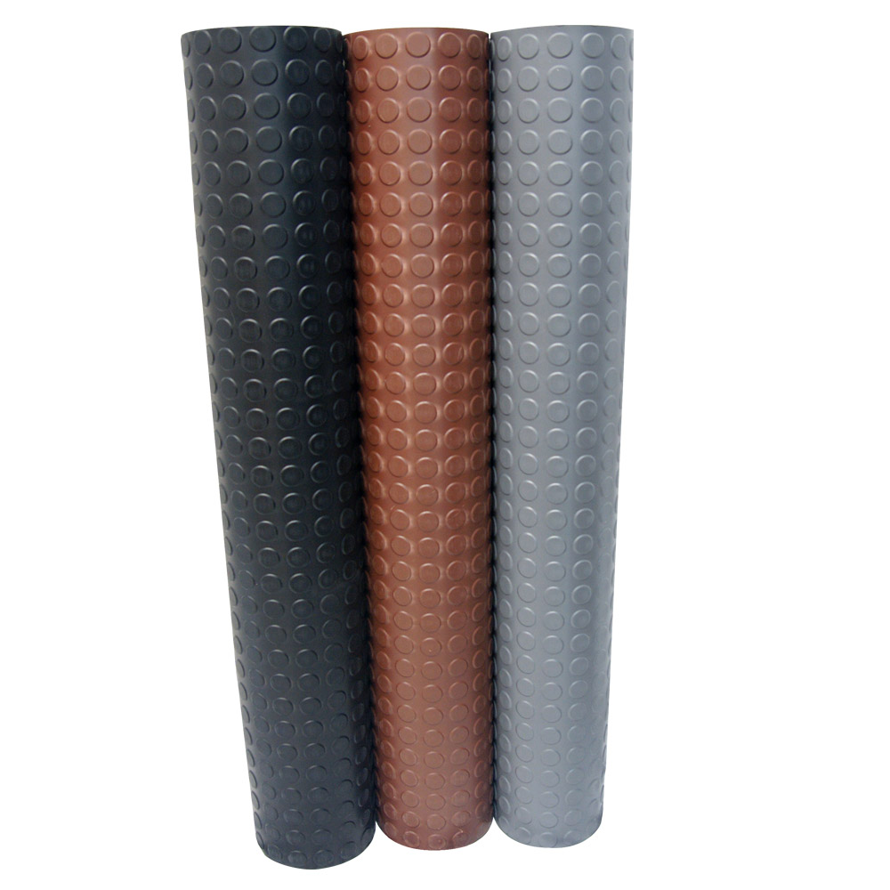 Three standing Goodyear Coin-top rolls, one black, one chocolate brown, and one dark gray