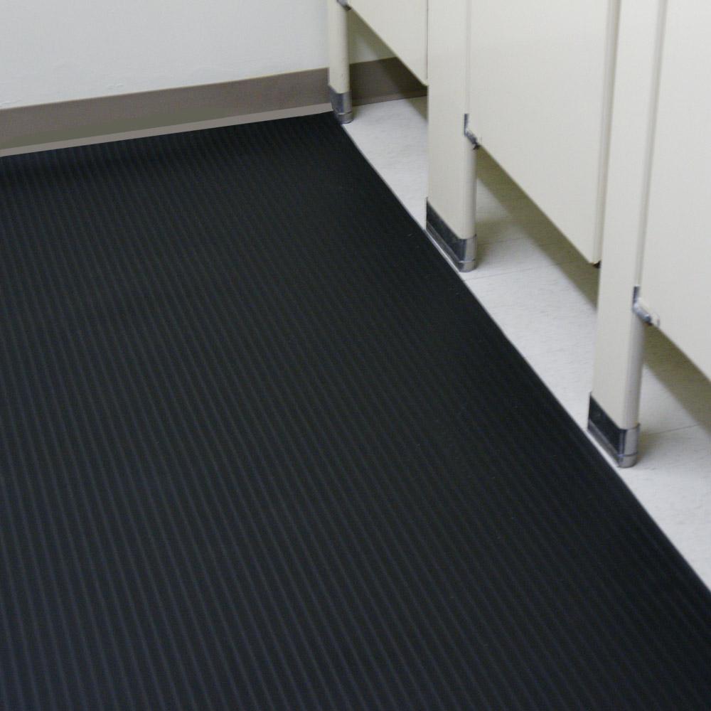 Corrugated composite rib rubber mat in a bathroom