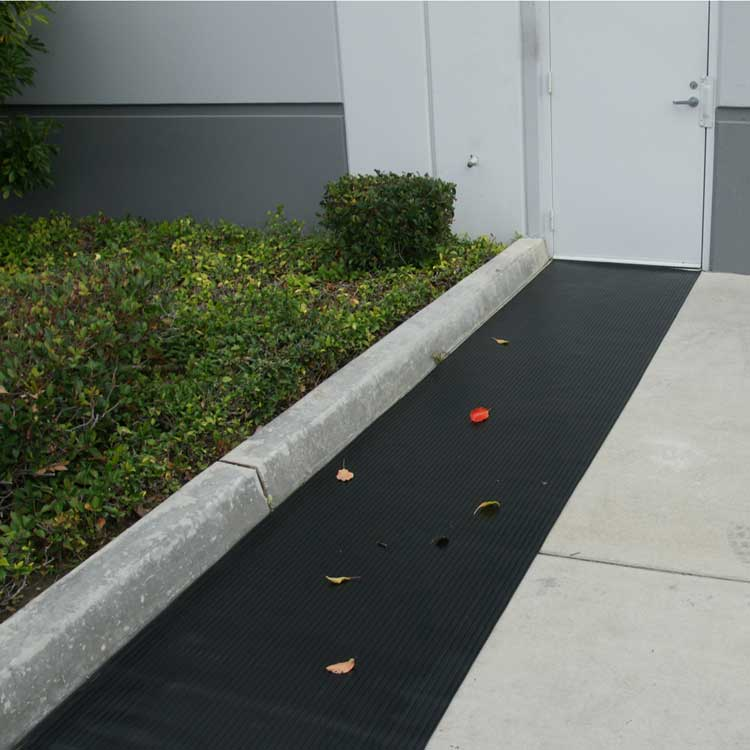 black corrugated wide rib runner mat placed outside business door