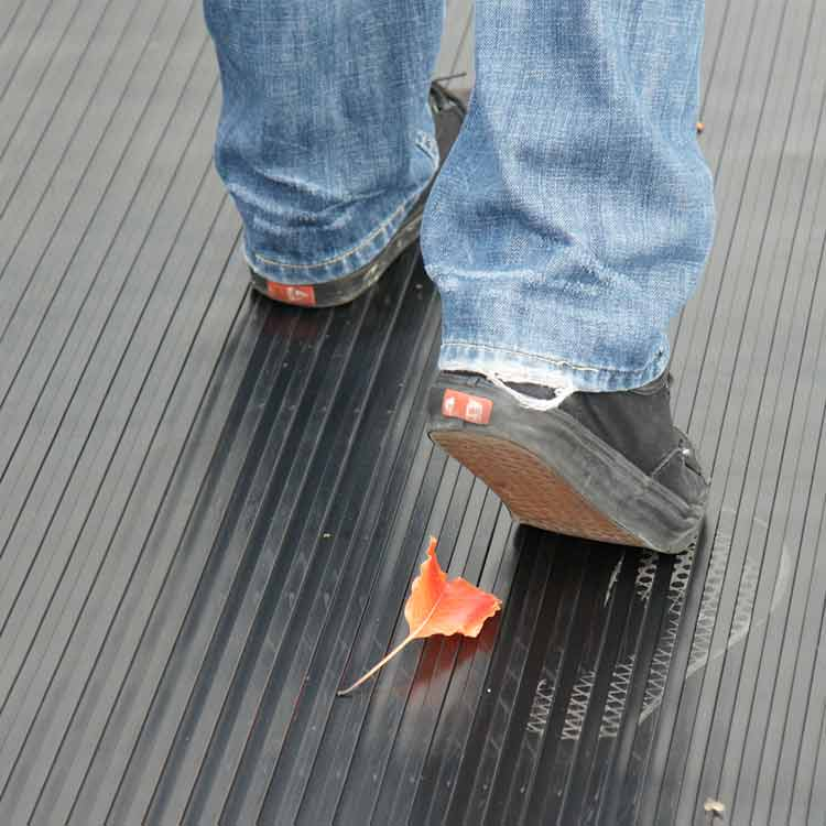 Person walking on a Wide Rib Rubber Mat