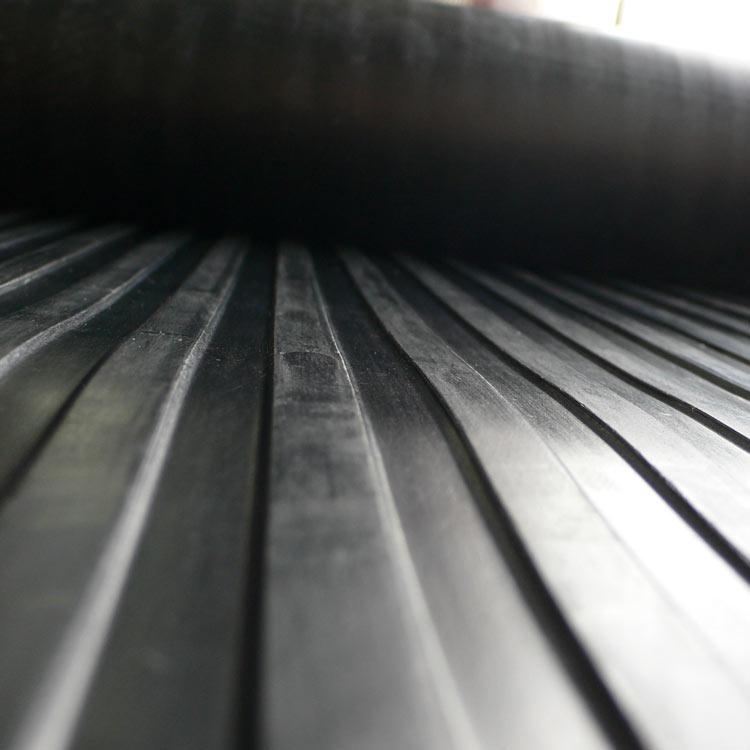 close up shot of black corrugated wide rib runner mat