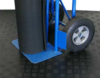 Hand truck with rubber roll on diamond grip floor