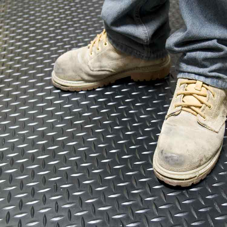 Person standing on Diamond Plate Rolled Rubber Matting