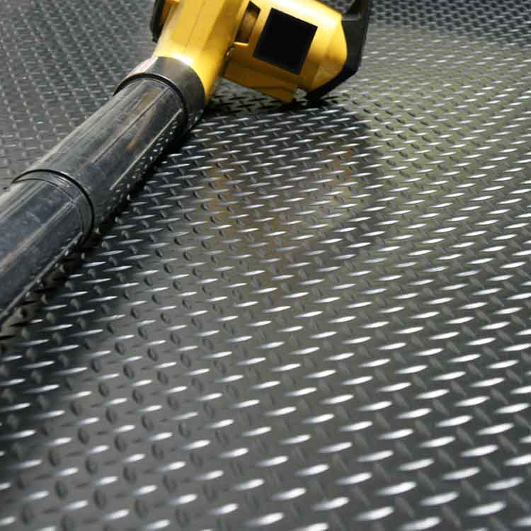 tool on top of diamond plate rubber roll matting