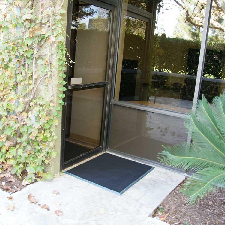 Door Scraper Mat on cement outside of an office building