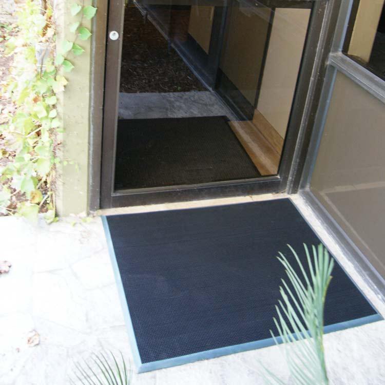 Door scraper on cement outside of an office building