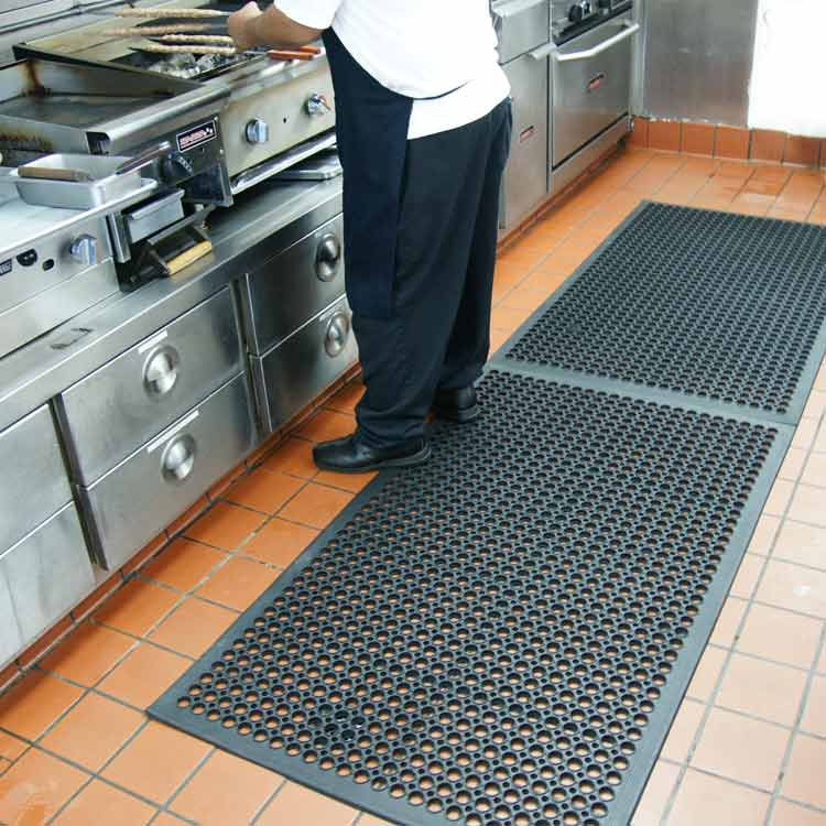 Chef using fryer while standing on Black Dura-Chef Kitchen Mat
