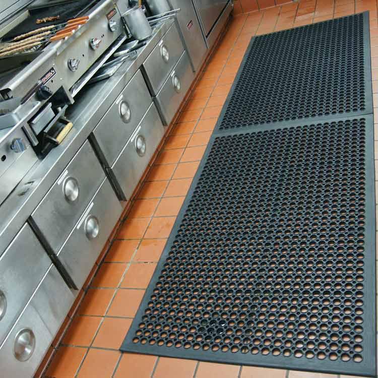 black dura chef anti-fatigue kitchen mat in commercial kitchen