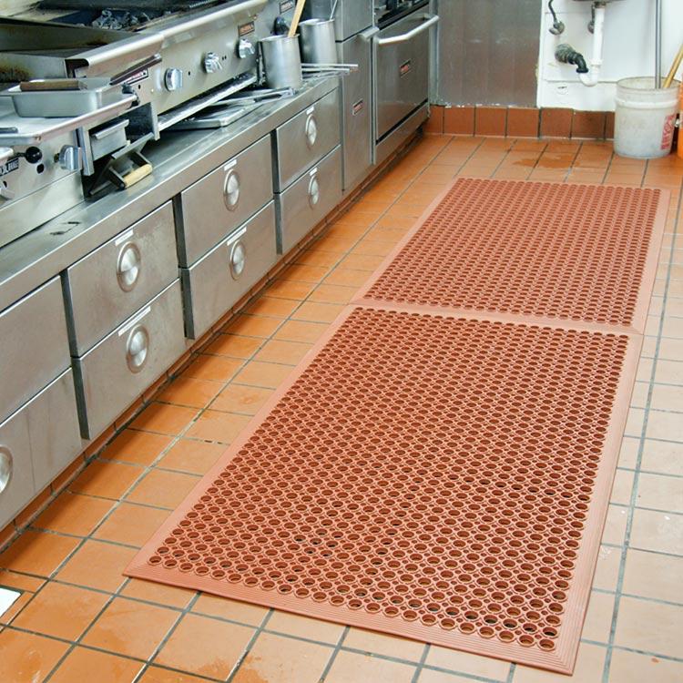 orange dura chef anti-fatigue kitchen mat in commercial kitchen