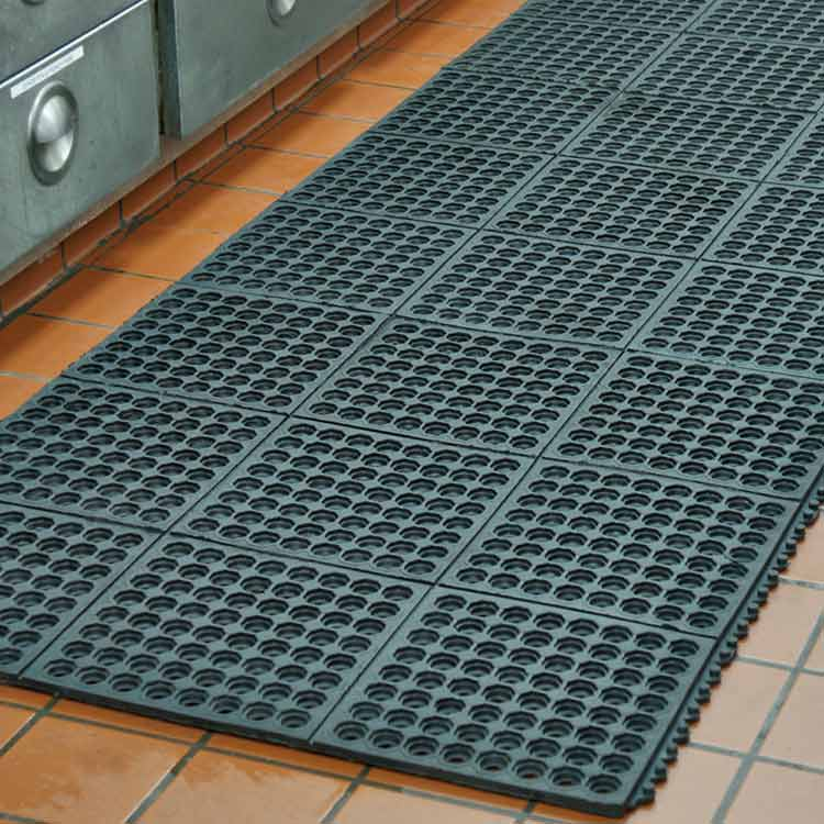 Close-up of Black Dura-Chef Drainage Mat on orange tile