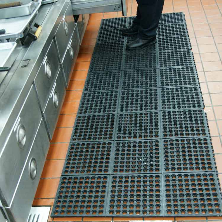 Person standing on Dura-Chef rubber mat opening drawer