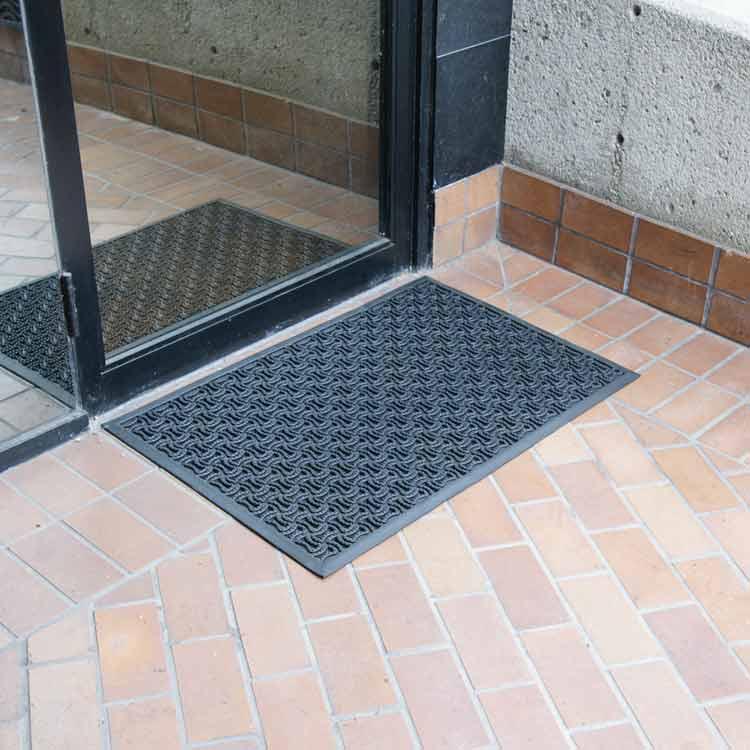 black Dura-Scraper Drainage Mat outside of a door